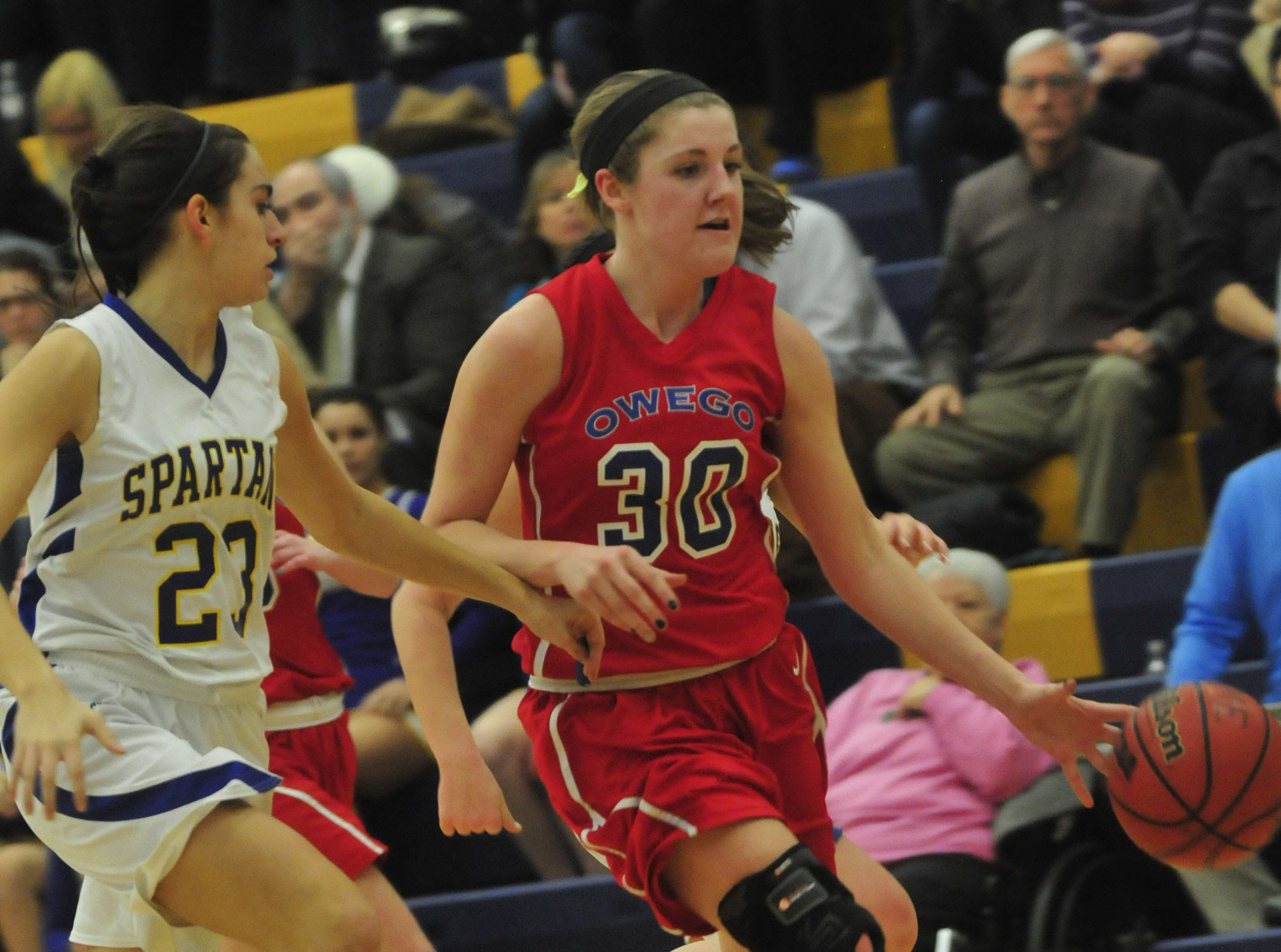 2014: Owego's Emily Merrill dribbles the ball past Maine-Endwell's Carla Spera in Wednesday's STAC semifinal. Merrill scored 16 points in Owego's 62-60 victory.