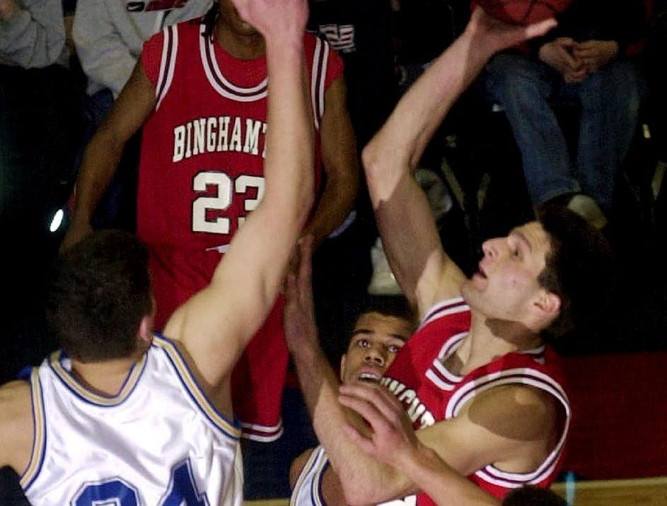 2001: Binghamton's Kevin Micha, right, goes up for a basket mid-way through the first half as Oneonta's Mike Konstanty, left, and Jim Hurtubise, bottom right, try to block his shot during Fri night's game.