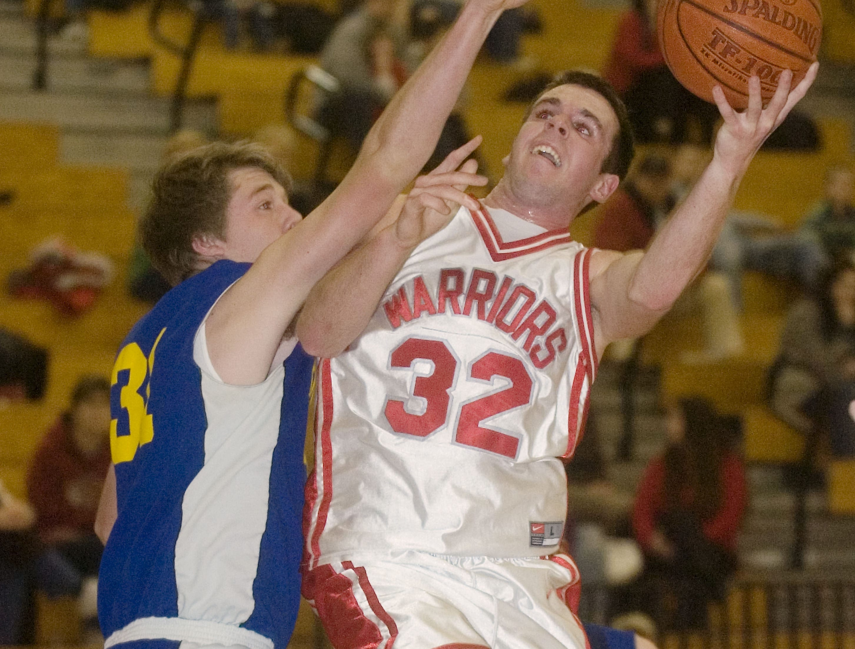 2009: Oneonta's Jacob VanDusen, left, defends Chenango Valley's Tom Hull in the second quarter of Tuesday's game at CV.