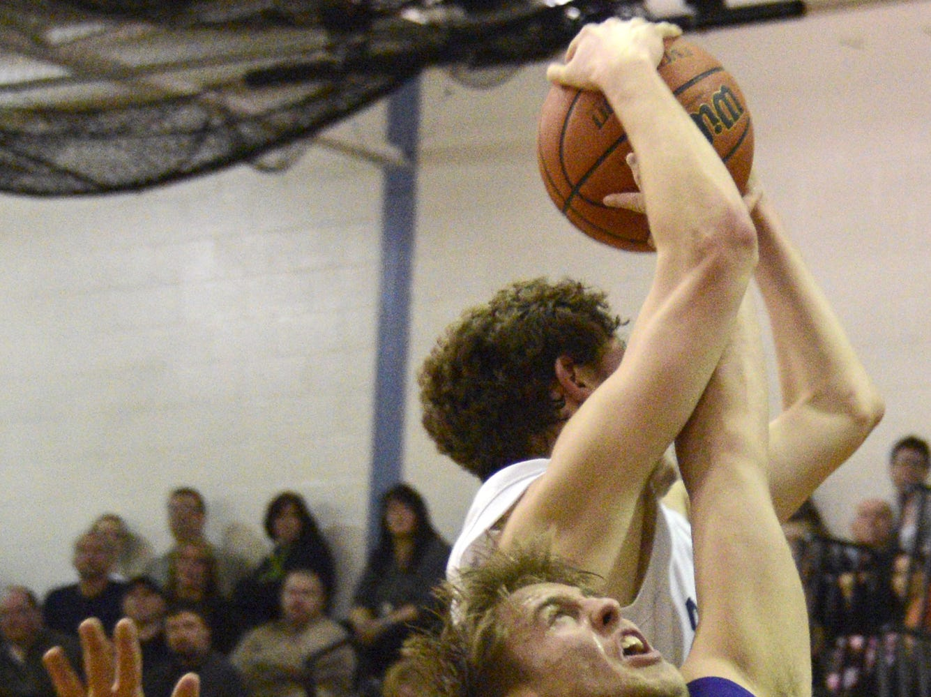 2013: Colin Manchester of Susquehanna Valley grabs the rebound over Norwich's Grant Brightman in the second half of Tuesday's STAC game in Conklin.