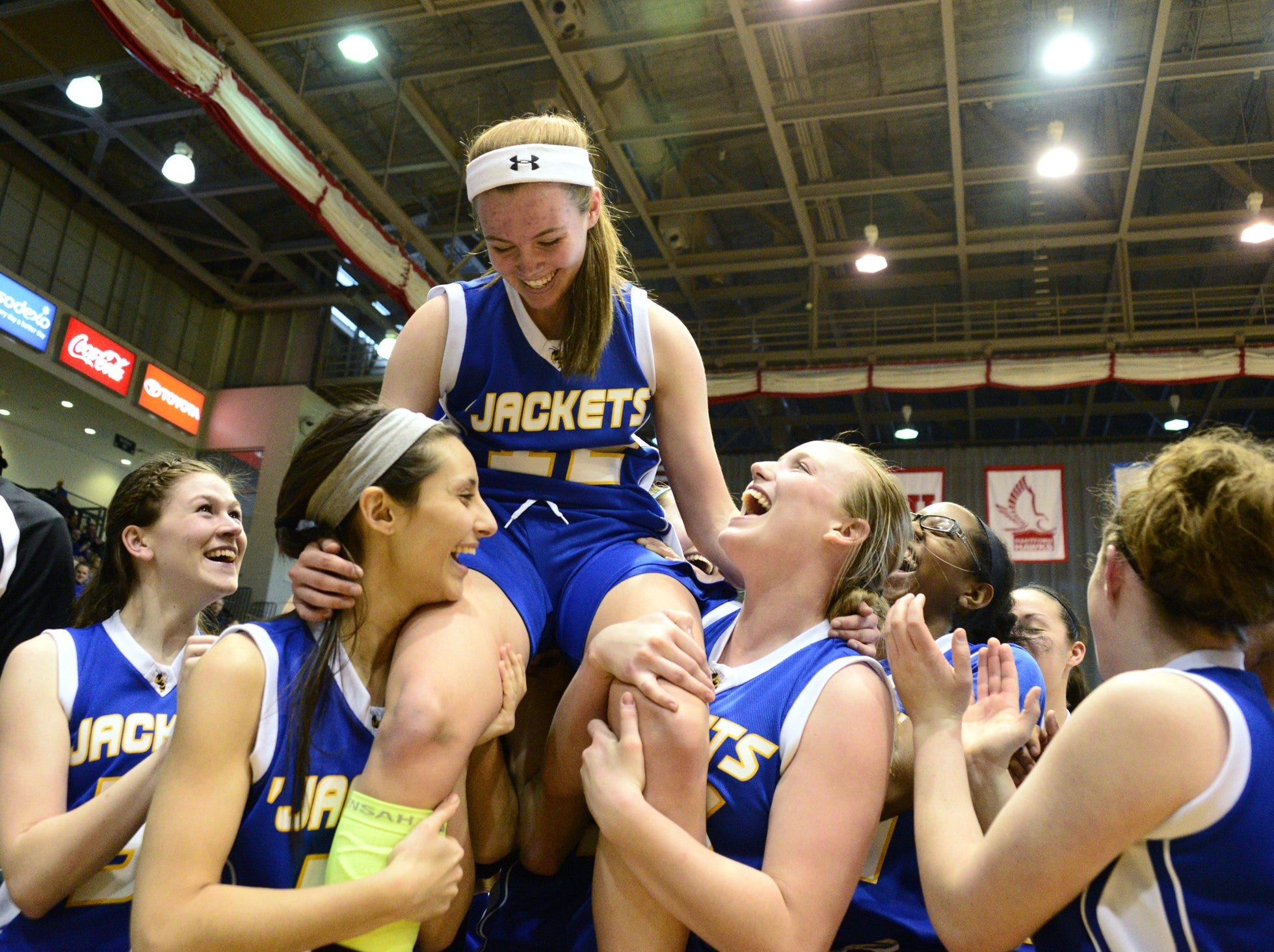 2013: Oneonta's Rachel Wessells and Kelsey Baker hoist Minnie Webster onto their shoulders to celebrate Webster's winning basket Sunday.