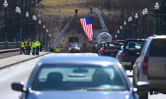 Community members and members of the DOT line the streets of Owego on Monday, March 25, following the funeral of Dennis Matthew Howe. Howe was employed by the New York State Department of Transportation and died from injuries following a March 13 collision on Route 17 in Tioga County.