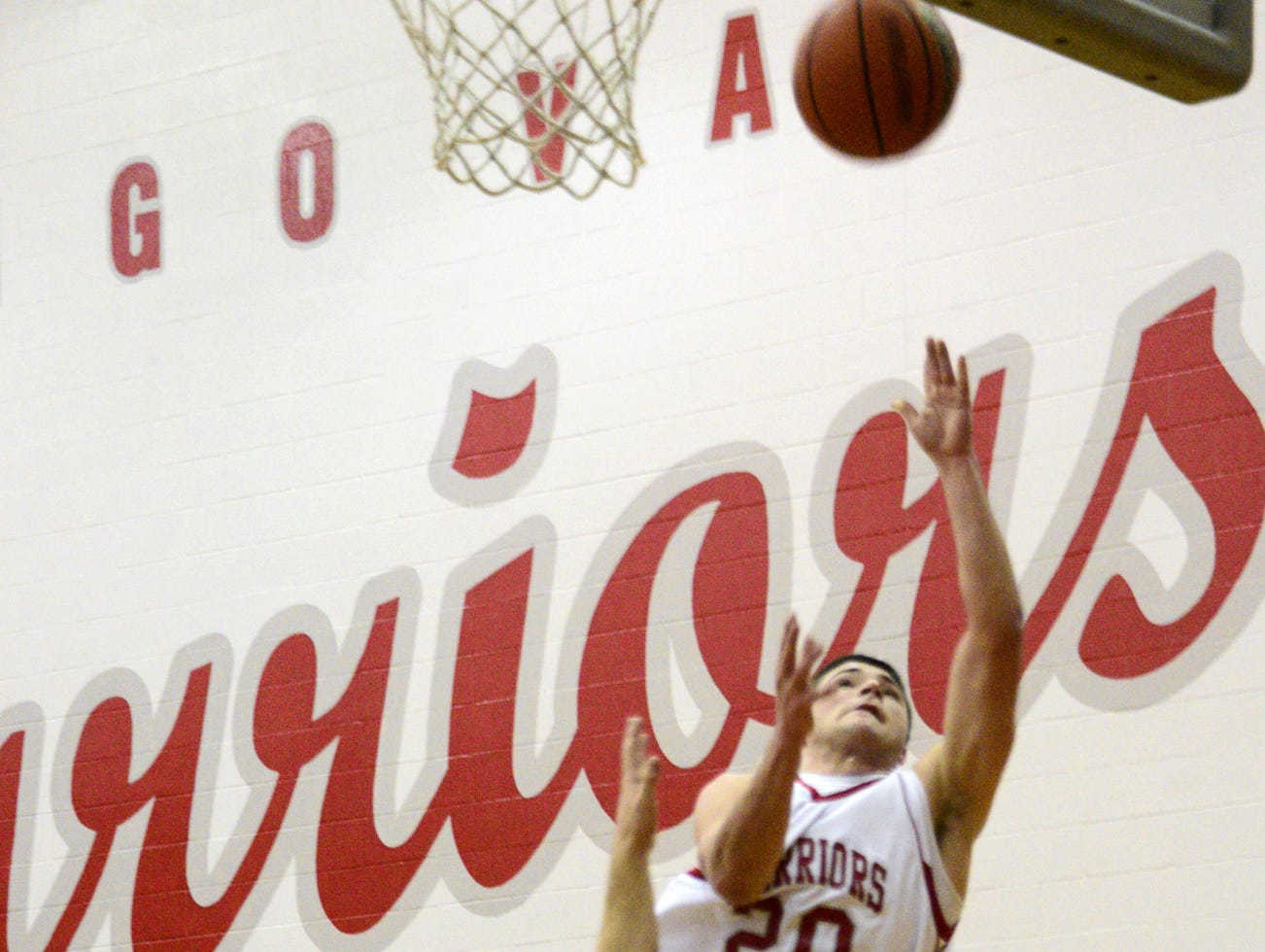 2012: Chris Ruffo of Chenango Valley shoots over Norwich's Michael Oralls in the 1st half of Wednesday's game at CV High School. Ruffo scored 21 points, but Norwich won, 61-47.