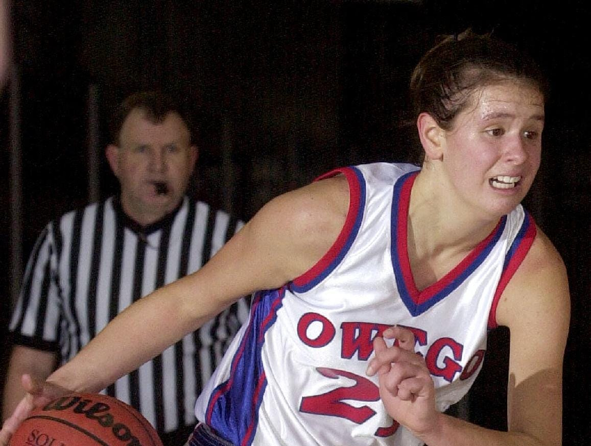 2002: Owego Free Academy's Kyle Dougherty, above, drives toward the basket in a game against Waverly at the Broome County Veterans Memorial Arena. Dougherty is the girls high school player of the year.