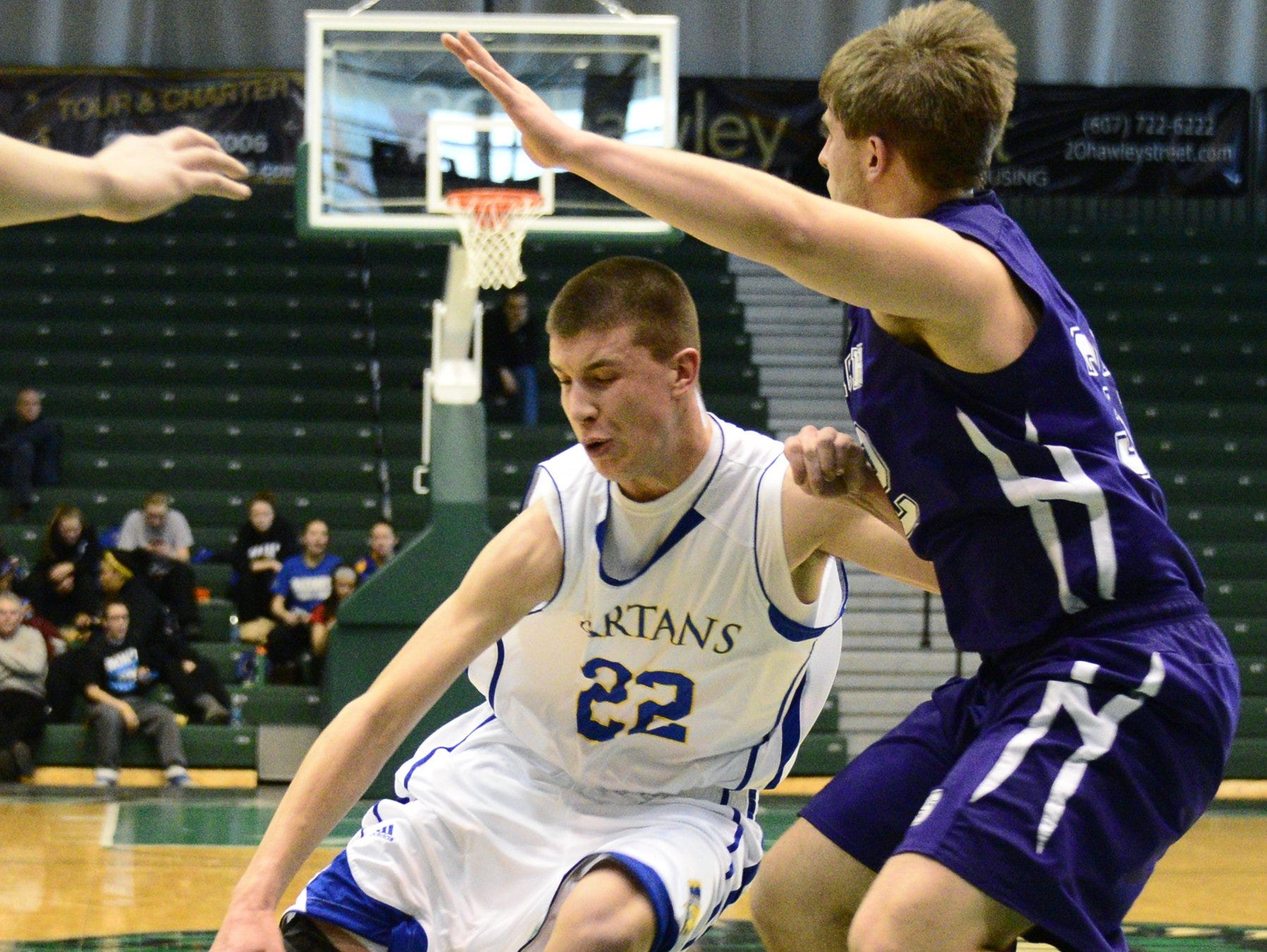 2013: Jake Sinicki of Maine-Endwell moves around Grant Brightman of Norwich in the first half of the STAC boys championship game held at the Events Center at Binghamton University.