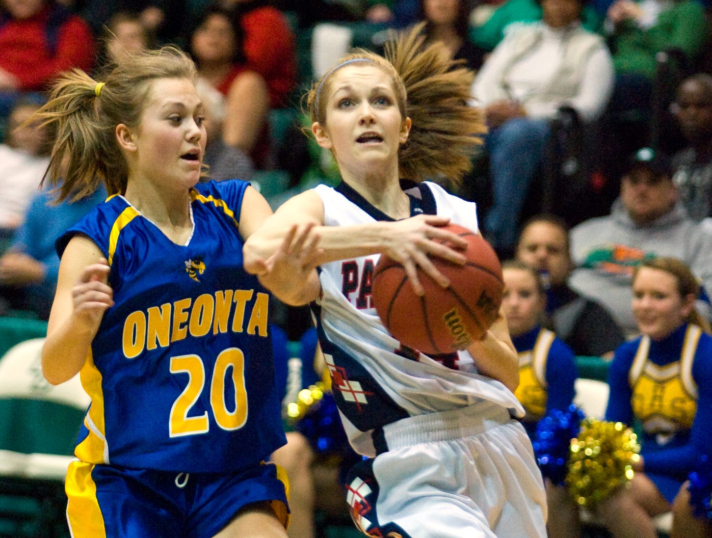2011: Binghamton's Alexis Esworthy charges the basket as Oneonta's Hayley Dower defends Saturday evening during the STAC basketball Championships at the Binghamton University Events Center in Vestal.