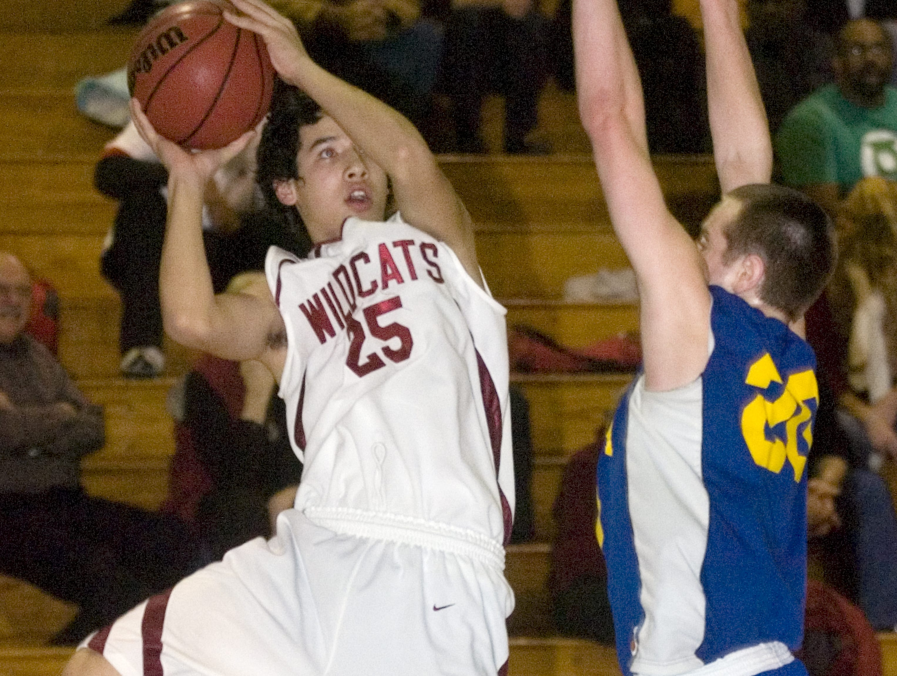 2008: Johnson City's Gil Choi, left, goes up against Oneonta's Ben Ehrets in the second quarter of Tuesday's game at JC.
