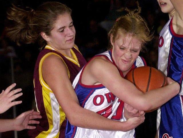 2002: Whitney Point's Kristen Wittig, left, and Owego Free Academy's Danielle Miller, right, battle for possesion of the ball in the second half of Friday night's championship win.