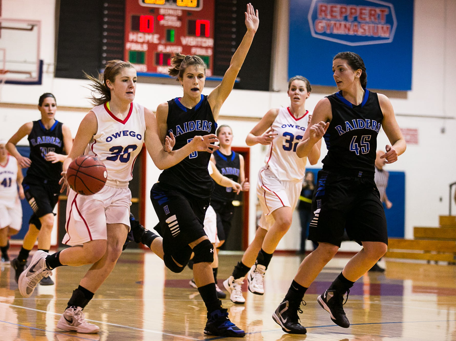 2013: Emily Merrill, left, brings the ball up court against Horseheads? Tess Wicks in the STAC semifinals Wednesday at Owego.