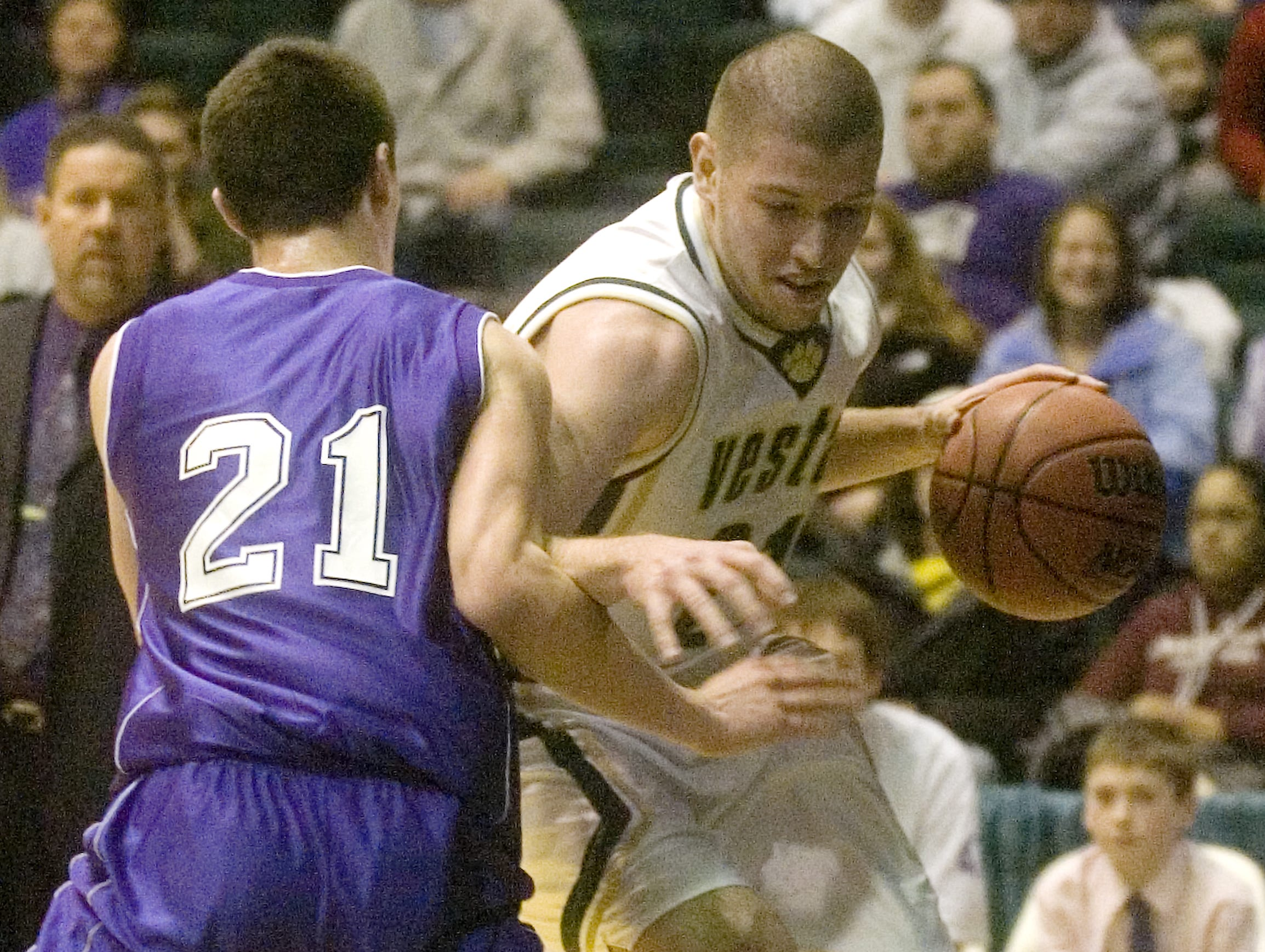 2009: Norwich's David Carson, left, guards Vestal's Cameron Boyden in the first quarter of Saturday's STAC finals game at the Events Center.