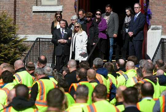 Dennis Matthew Howe's widow, Alycia Haus, and family members leave Owego United Methodist Church following Howe's funeral. Howe, a DOT worker, was killed March 13 following a collision on Route 17 in Tioga County.