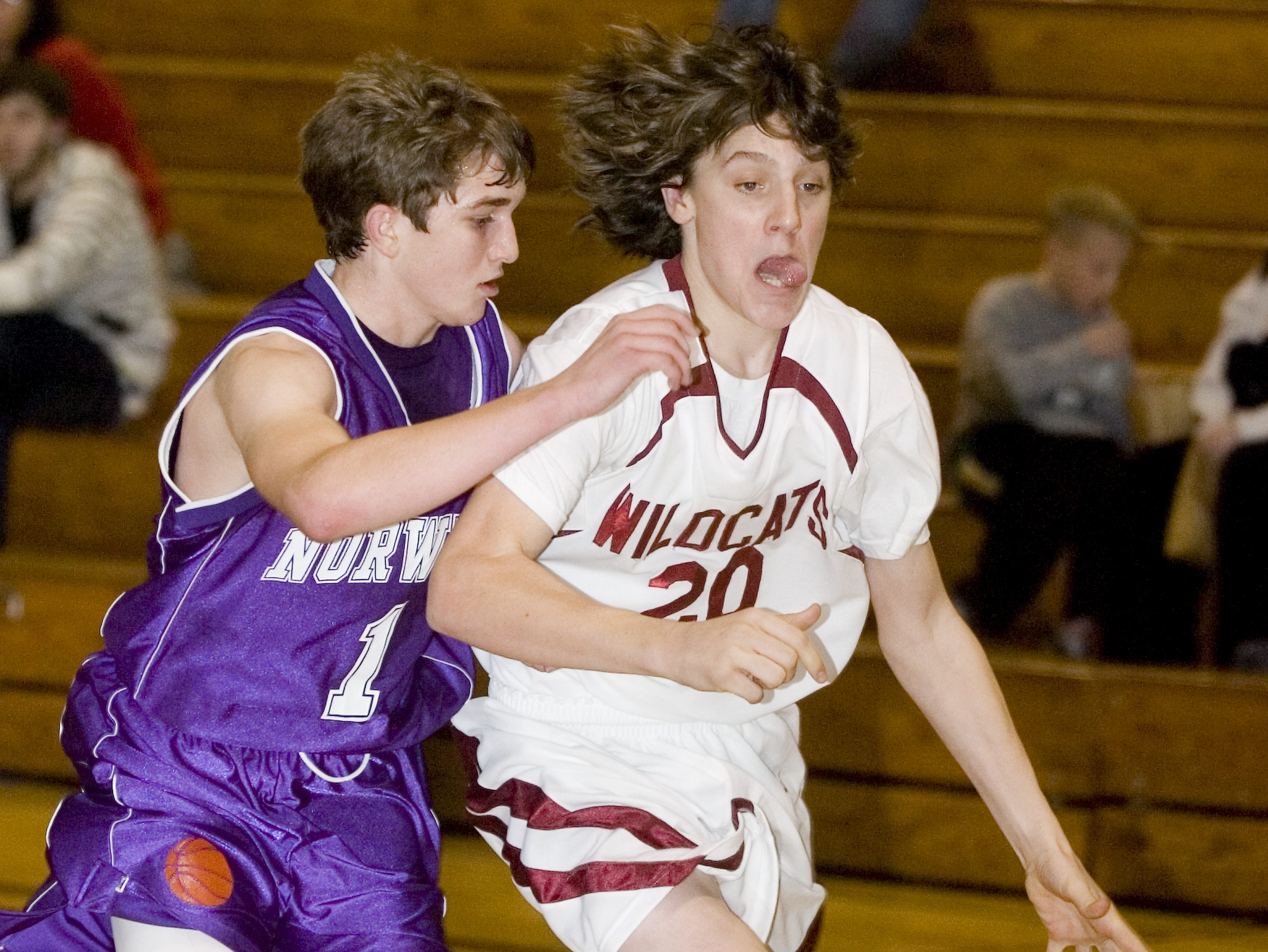 2005: Johnson City High School's Branden Kuzel, right, works past Norwich High School's Timmy Clark in the first half of the Tuesday night game at Johnson City High School.