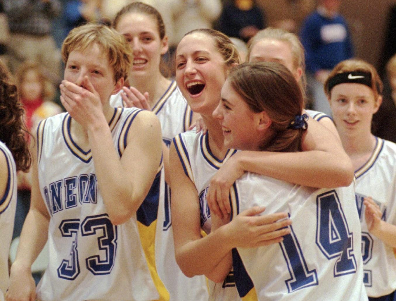 Oneonta players celebrate after winning the state championship in Troy, N.Y. on Sunday, March 22, 1998.