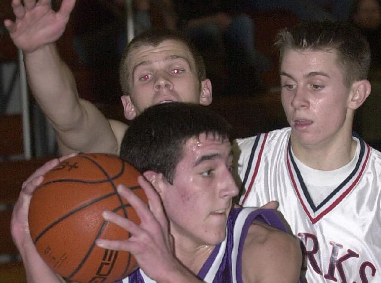 2001: Norwich's Brian Collier grabs a rebound away from Chenango Forks' Chris Spencer, left, and Nick Mirabito durning the first quarter.