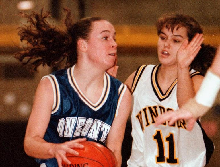1998: Oneonta Kelig Sosa looks for room to pass around defending Windsor Samantha Bedford during Saturday's varsity game at Windsor high school.