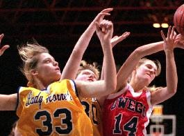 1997: Harpursville's Angela Rought, left, Nicole Rowe, and Owego's Gretchen Reschke grab for a rebound during opening round action of the John McCarthy Girls Basketball Tournament at the Broome County Veterans Memorial Arena.