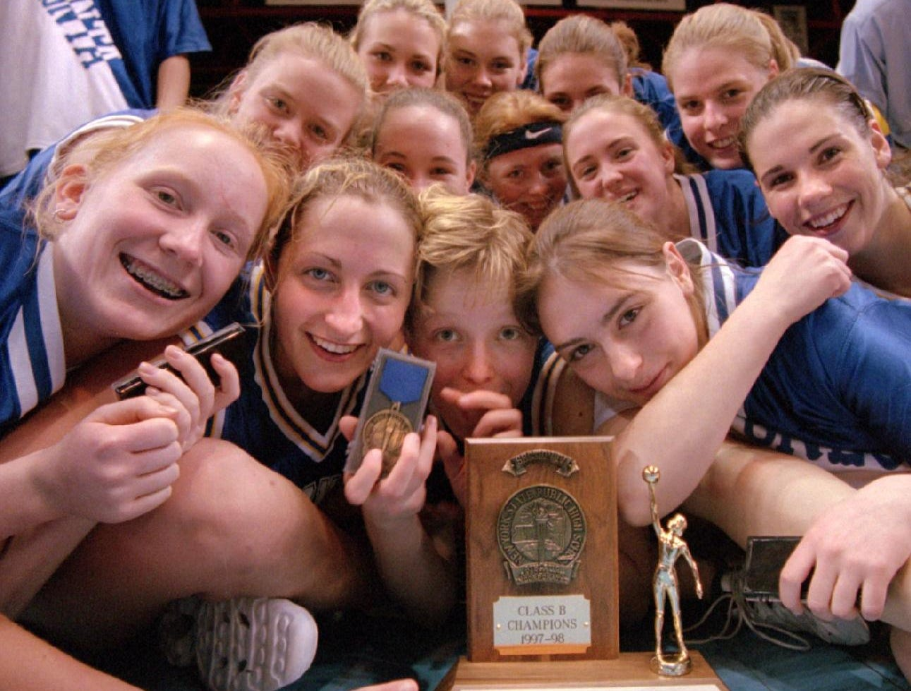 1998: The Class B Sectional Champions the Oneonta Yellow Jacket Girls Varsity Basketball team mugs for the camera after their 61 to 43 victory over the Maine-Endwell Spartans.