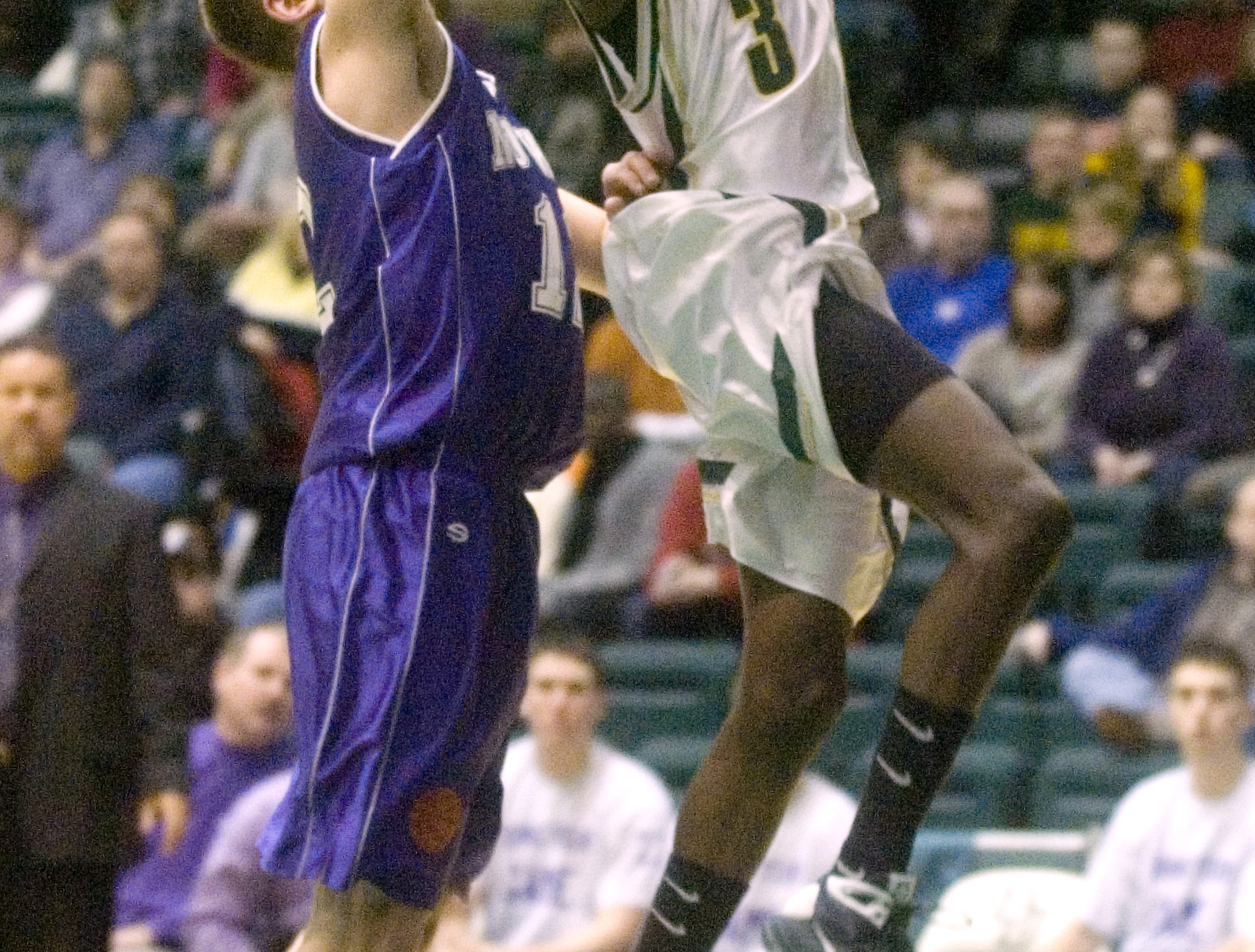 2009: Norwich's Joshua Borfitz. left, tries to stop a shot by Vestal's Richie Sebuharara in the first quarter of Saturday's STAC finals game at the Events Center.