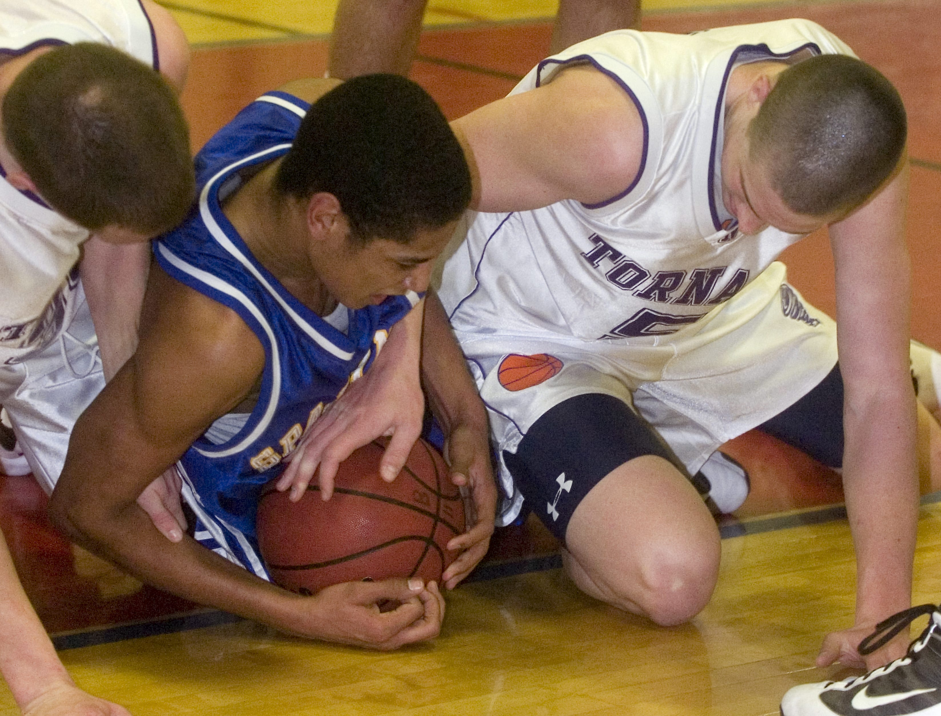 2010: Maine-Endwell's Nate Burgo, middle, protects the ball from Norwich's Richard Bonney, right, and Andrew Austin in the fourth quarter of Saturday's game at Binghamton High School.