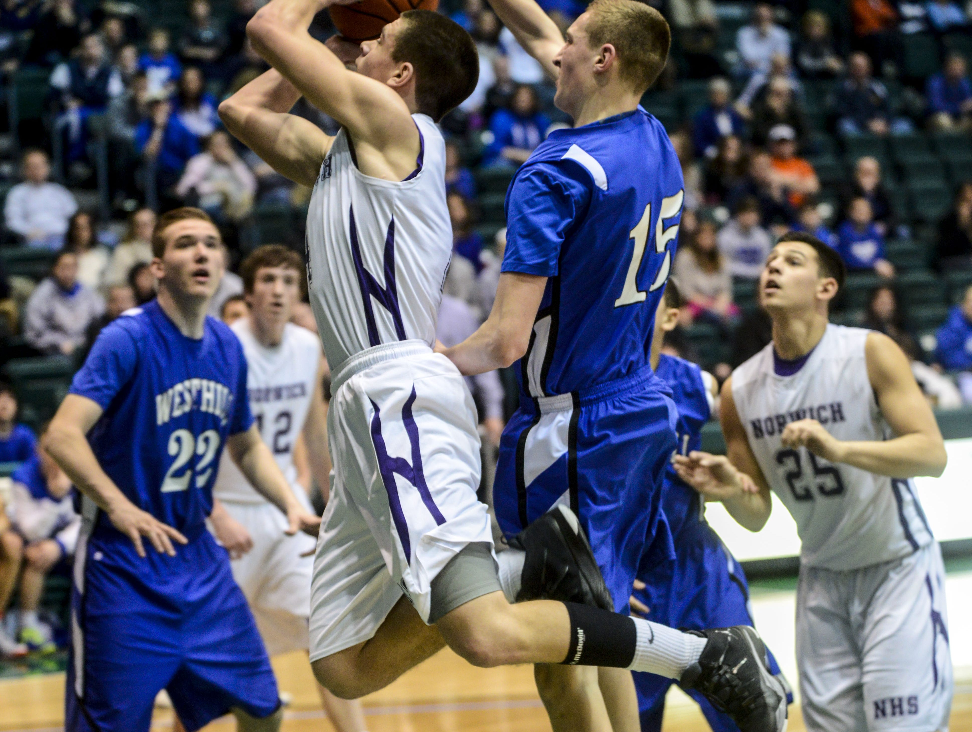 2014: Norwich's Michael Sutton gets the ball stripped away by Westhill's Dan O'Connell in the Class B state quarterfinal Saturday at the Events Center. Sutton finished with 28 points, but Westhill won, 56-53, in overtime.