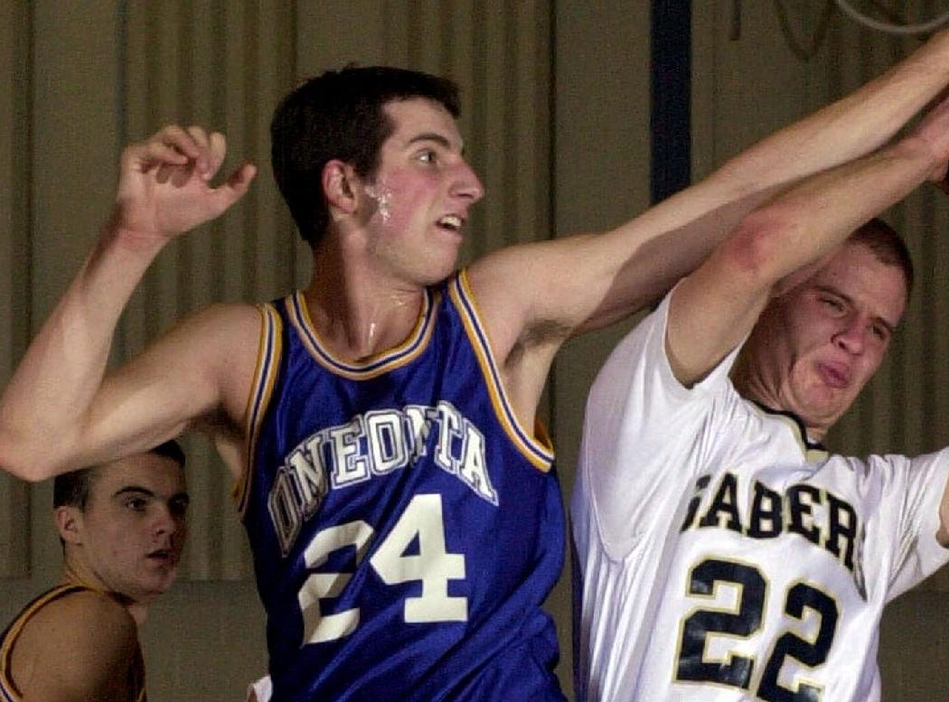 2001: Oneonta's Garrett Brignoli, left, is called for fouling Susquehanna Valley's Andy Petrau, right, with about 4 minutes left to play during the first half of Saturday's game.