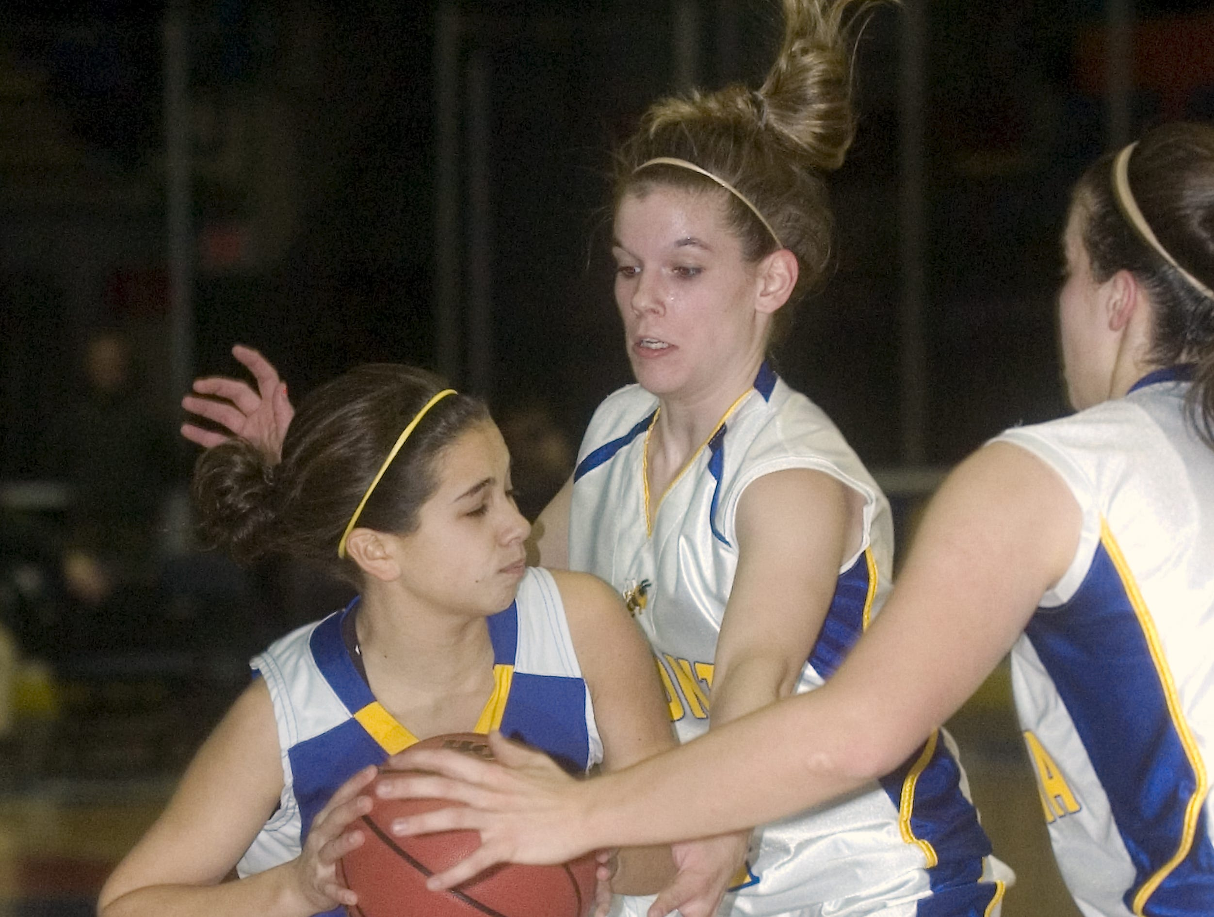 2009: Lansing's Nina Lindberg, left, is double-teamed by Oneonta's Sienna Wisse, right, and Jenn Dilello in the second quarter of Friday's Section 4 Class B girls basketball finals at Broome County Veterans Memorial Arena.