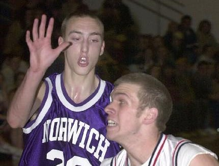 2001: Chenango Forks' Chris Spencer stops to pull up for a shot as Norwich's Tim McKown tries to defend.