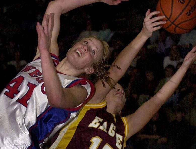 2002: Owego Free Academy's Danielle Miller, left, collides with Whitney Point's Courtney Ross, right, as they go for a rebound on a missed Whitney Point foul shot attempt late in the fourth quarter of the Eagles win Fri night at the Broome County Veterans Memorial Arena.