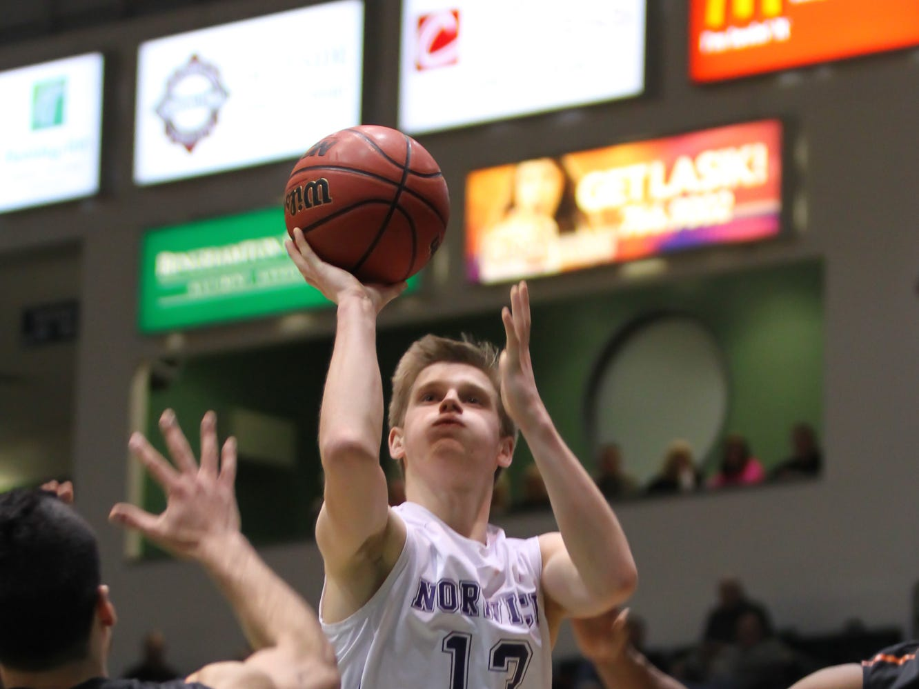 2014: Zan Stewart shoots over the Union-Endicott defense as Norwich won its first STAC boys basketball championship since 1994 on Friday night at the Events Center. Stewart had 15 points in the 85-67 victory.