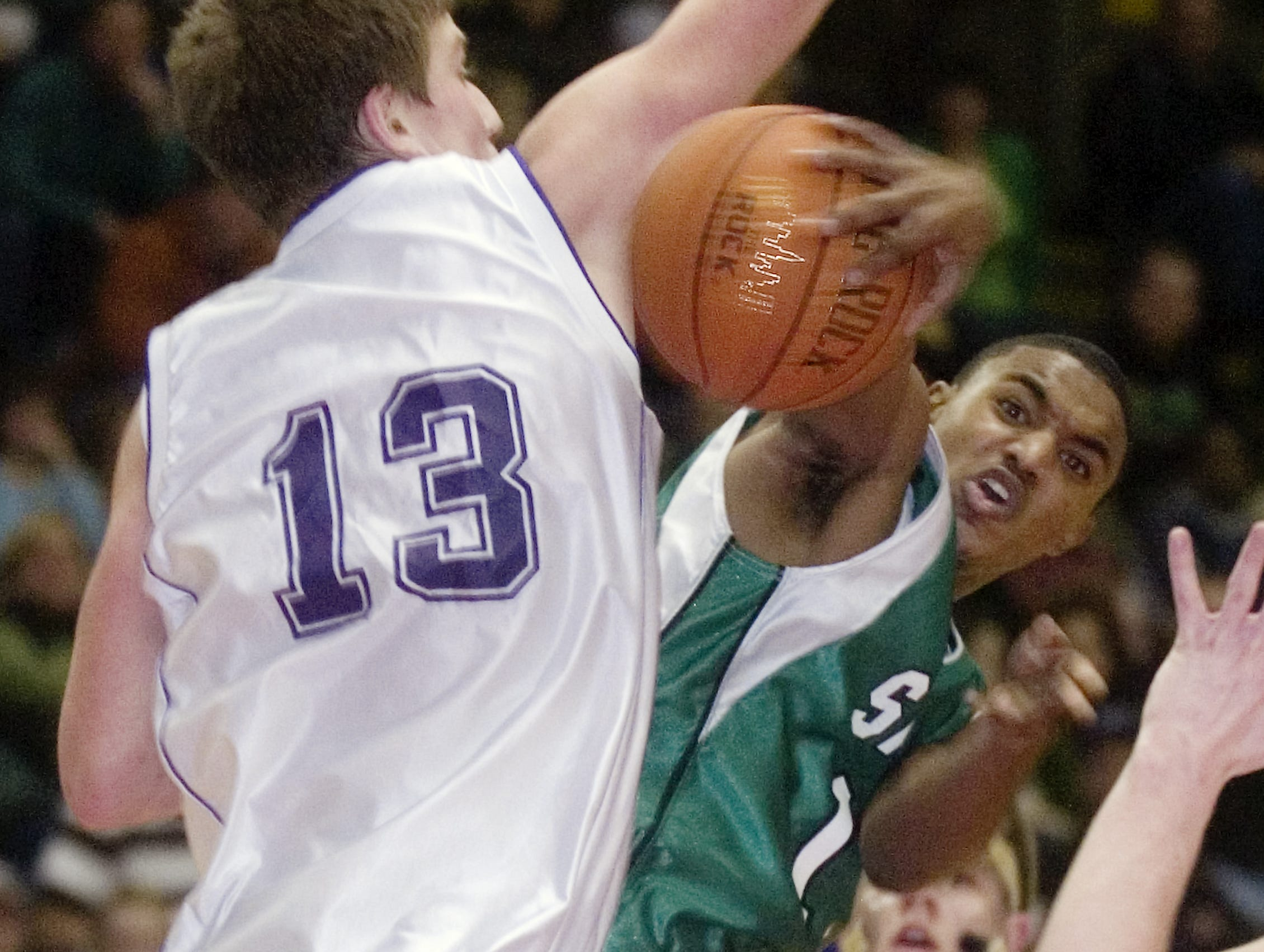 2008: Norwich's Vaughn Labor, left, defends Seton Catholic Central's Greg Johnson in the second quarter of Tuesday's STOP-DWI Holiday Classic game at Broome County Veterans Memorial Arena.
