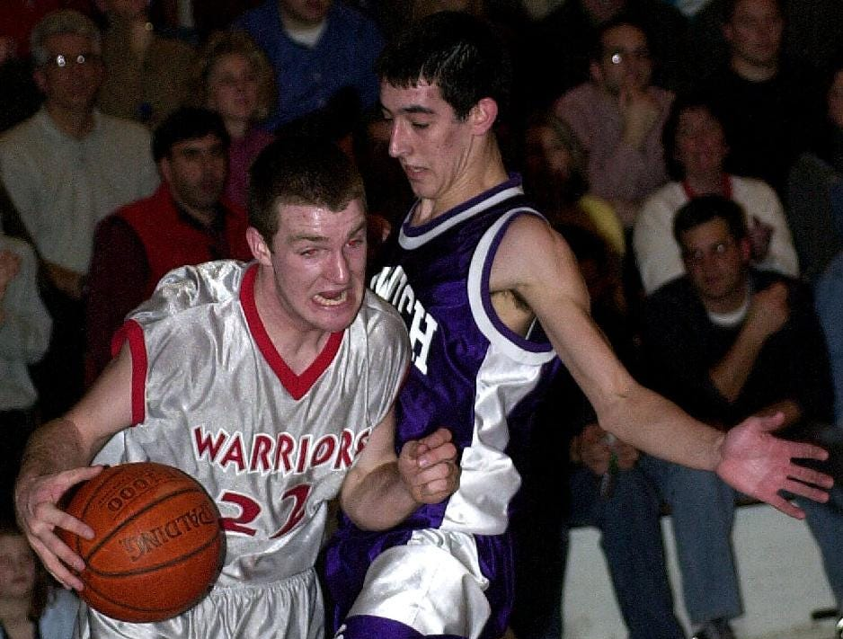 2001: Chenango Valley's Brendan Sheehan, left, drives past Norwich's Brian Collier, right, with about 2:30 left to play Friday night.