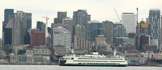 The Washington State Ferry Wenatchee departs Seattle for Bainbridge Island on Monday, March 25, 2019.