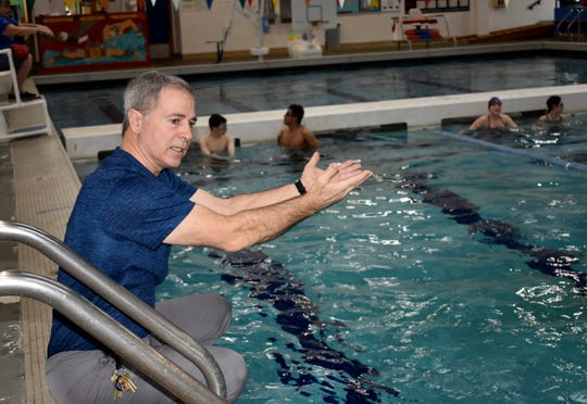 Olympic High School teacher Steve Lutz guides his first-period swim class on proper stroke technique.