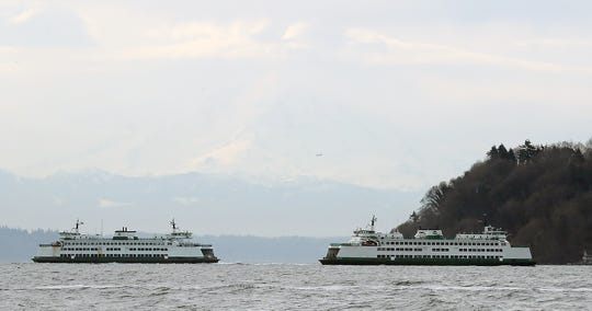 Washington State Ferries M/V Cathlamet and the M/V Chelan work the Southworth-Fauntleroy route on Monday, March 25, 2019.