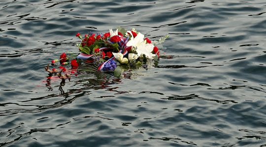A  wreath in honor of fallen Coast Guard Petty Officer Ronald Gill floats in Puget Sound on Monday. A ceremony honoring Gill is held yearly to honor the memory of the Coast Guardsman who was killed after he was ejected from his patrol boat in 2007.