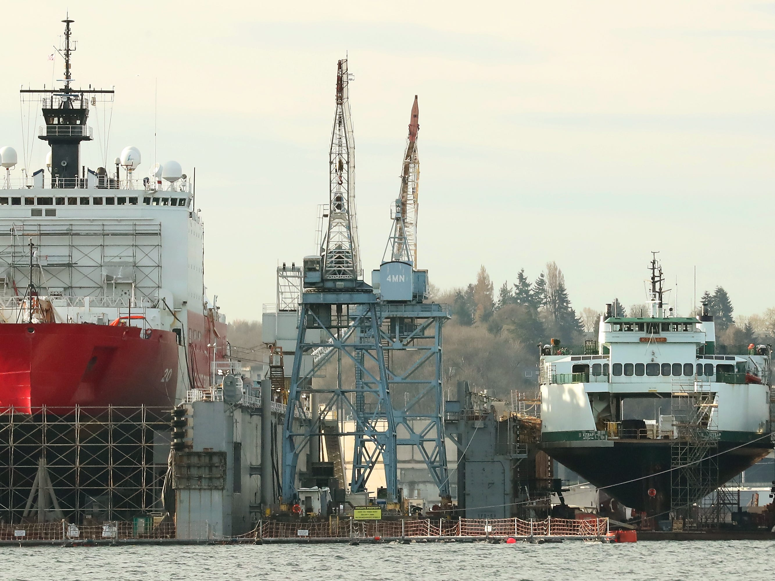 The USCGC Healy and the Washington State Ferry Kitsap sit side by side in the Vigor dry docks in Seattle on Monday, March 25, 2019.