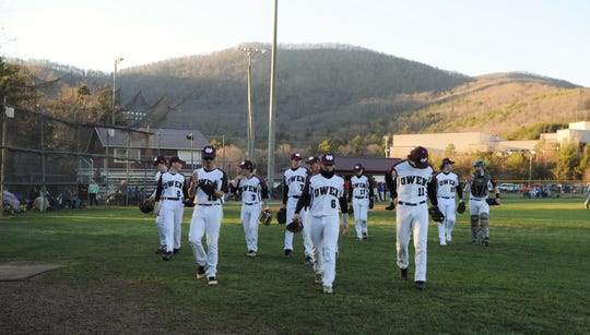 The Owen Warhorses head to the dugout after warming up before a loss at home to the Madison Patriots on March 19.