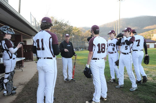Owen High School baseball coach Anthony Lee talks to his players before their March 19 home game against Madison.