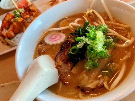 The miso ramen at Naoki Japanese Cuisine in Palm Bay was a lovely marriage of flavors that came with poached egg, seasoned bamboo shoots, green onion, seaweed and sesame seeds, .