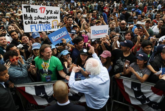 LOS ANGELES, CALIFORNIA - MARCH 23:  2020 Democratic presidential candidate U.S. Sen. Bernie Sanders (I-VT),  BOTTOM C, greets supporters at a campaign rally in Grand Park on March 23, 2019 in Los Angeles, California. Sanders, who is so far the top Democratic candidate in the race, is making the rounds in California which is considered a crucial 'first five' primary state by the Sanders campaign. California will hold on early primary on March 3, 2020.