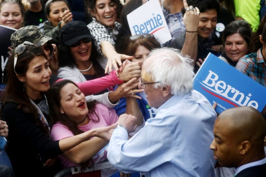 LOS ANGELES, CALIFORNIA - MARCH 23:  2020 Democratic presidential candidate U.S. Sen. Bernie Sanders (I-VT),  CENTER R, greets supporters at a campaign rally in Grand Park on March 23, 2019 in Los Angeles, California. Sanders, who is so far the top Democratic candidate in the race, is making the rounds in California which is considered a crucial 'first five' primary state by the Sanders campaign. California will hold on early primary on March 3, 2020.
