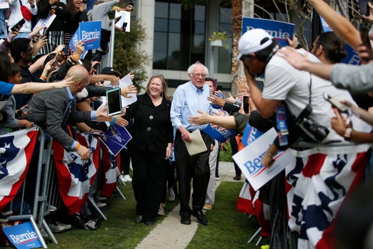 Democratic presidential candidate Sen. Bernie Sanders, I-Vt., center right, and his wife, Jane, arrive at a rally at Grand Park in Los Angeles, Saturday, March 23, 2019. The Vermont senator made a notable, second-place finish in California's 2016 presidential primary when he won 27 of 58 counties