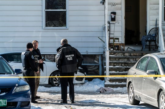 Burlington police set up a security perimeter around an apartment house at the corner of Clarke and Grant Streets Sunday morning, March 24, 2019, after a man was shot in the head. Police are looking for Alfred L. Wisher, 37, who they say witnesses identified at the shooter.