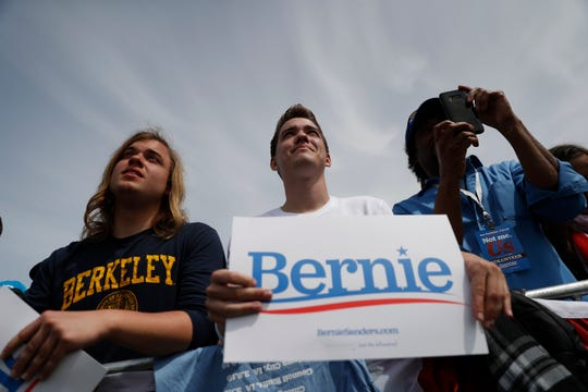 Supporters of 2020 Democratic presidential candidate U.S. Sen. Bernie Sanders (I-VT) listen during a campaign rally at Great Meadow Park in Fort Mason on March 24, 2019 in San Francisco, California.