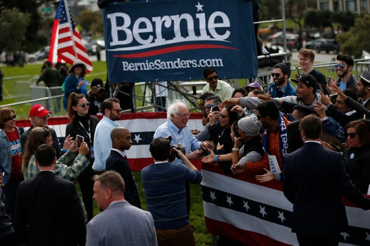 SAN FRANCISCO, CA - MARCH 24: 2020 Democratic presidential candidate U.S. Sen. Bernie Sanders (I-VT), center, greets supporters after a campaign rally at Great Meadow Park in Fort Mason on March 24, 2019 in San Francisco, California. Thousands are expected to attend the rally as Sanders continues his California swing in preparation for the early 2020 primaries.