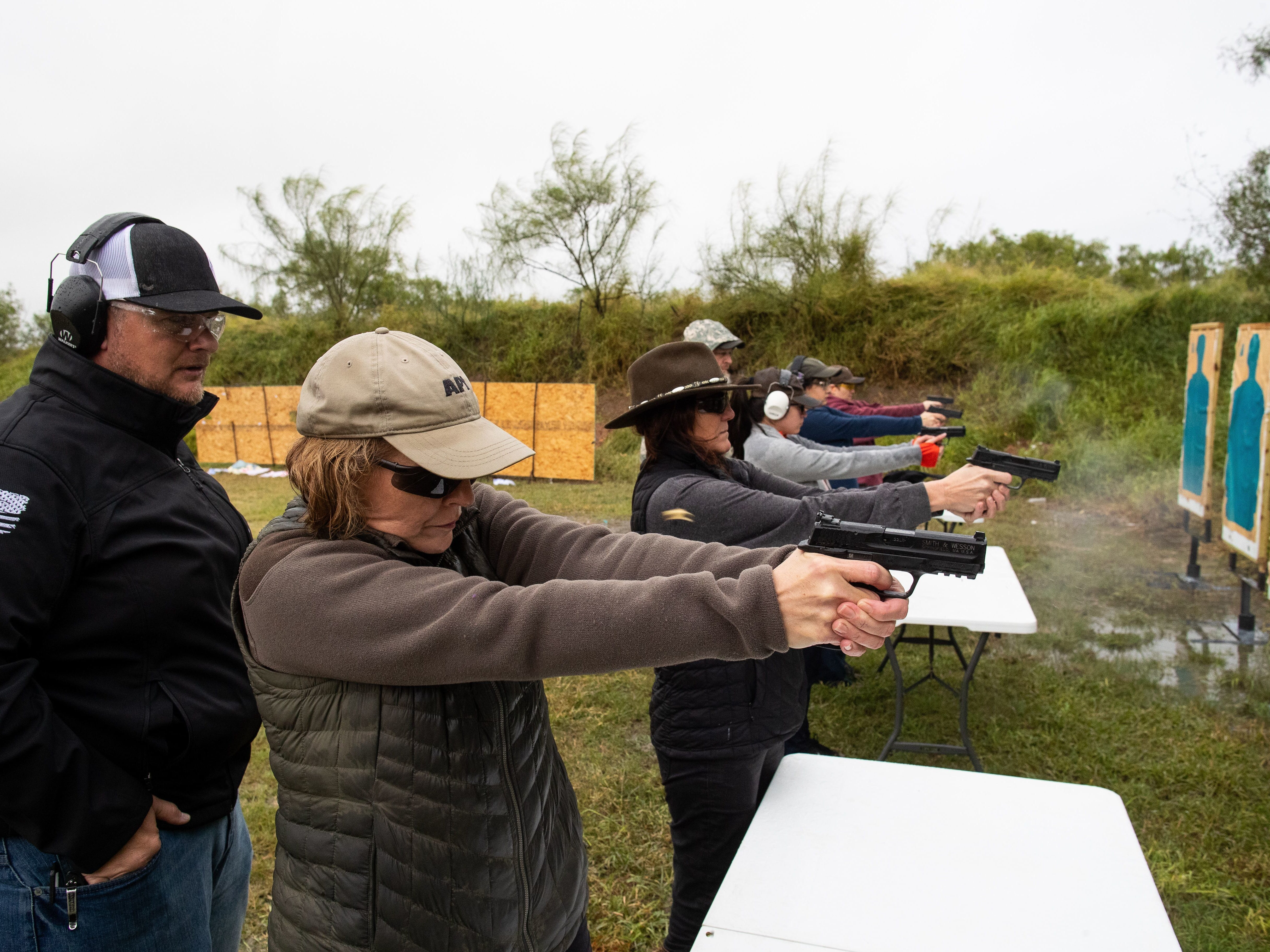 Judge Susan Barclay stands next to the 347th District Judge Missy Medary as they take a license to carry class along with other judges and courthouse workers at Starry Shooting Range in 2018.