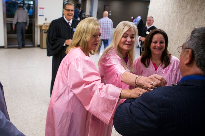 Susan Barclay, Title IV-D (from left) Judge, Deanne Galvan, County Court at Law 3 Judge, and Missy Medary, 347th District Court Judge, hand out a sticker to a district court bailiff as they hand out stickers to jurors arriving for jury duty at the Nueces County Courthouse in 2018. There are more women judges than ever in Nueces County.