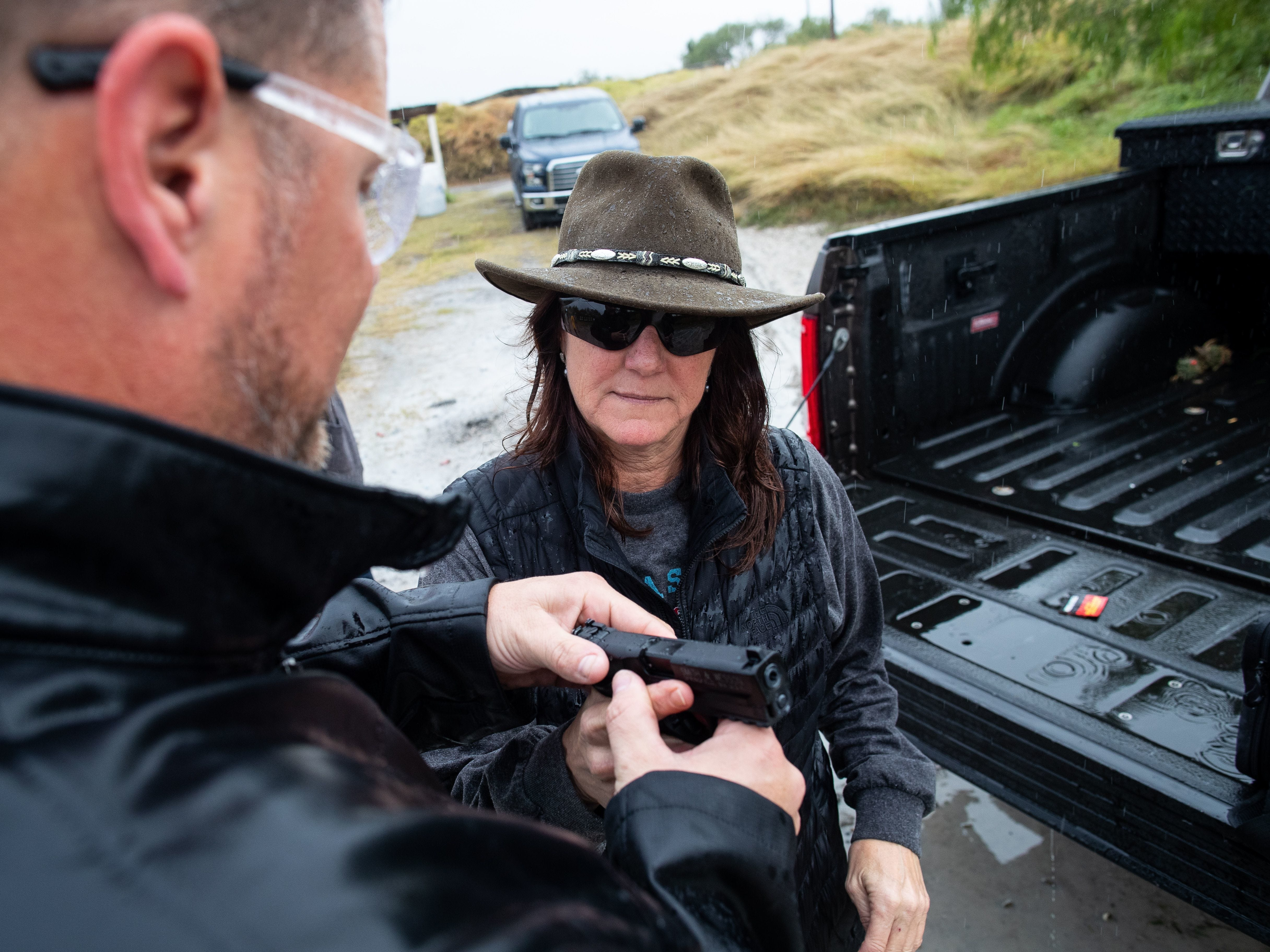 347th District Judge Missy Medary is shown how to use a new firearm as she takes a license to carry class along with other judges and courthouse workers at Starry Shooting Range in 2018. Medary is the first woman to serve as Presiding Judge of the Fifth Administrative Judicial Region.