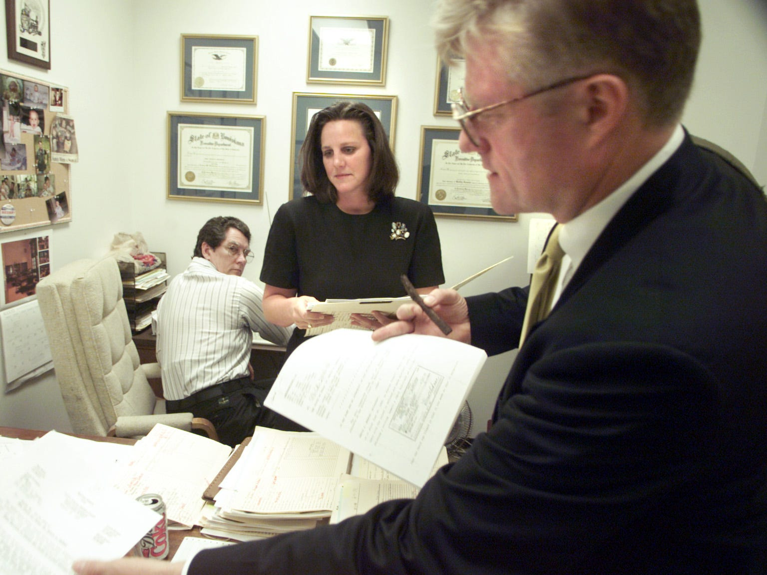 Then Assistant District Attorney Missy Medary and Chip Rudden discuss a case in 1999. Judge Missy Medary is the 347th District Court Judge and is the first woman to serve as Presiding Judge of the Fifth Administrative Judicial Region.