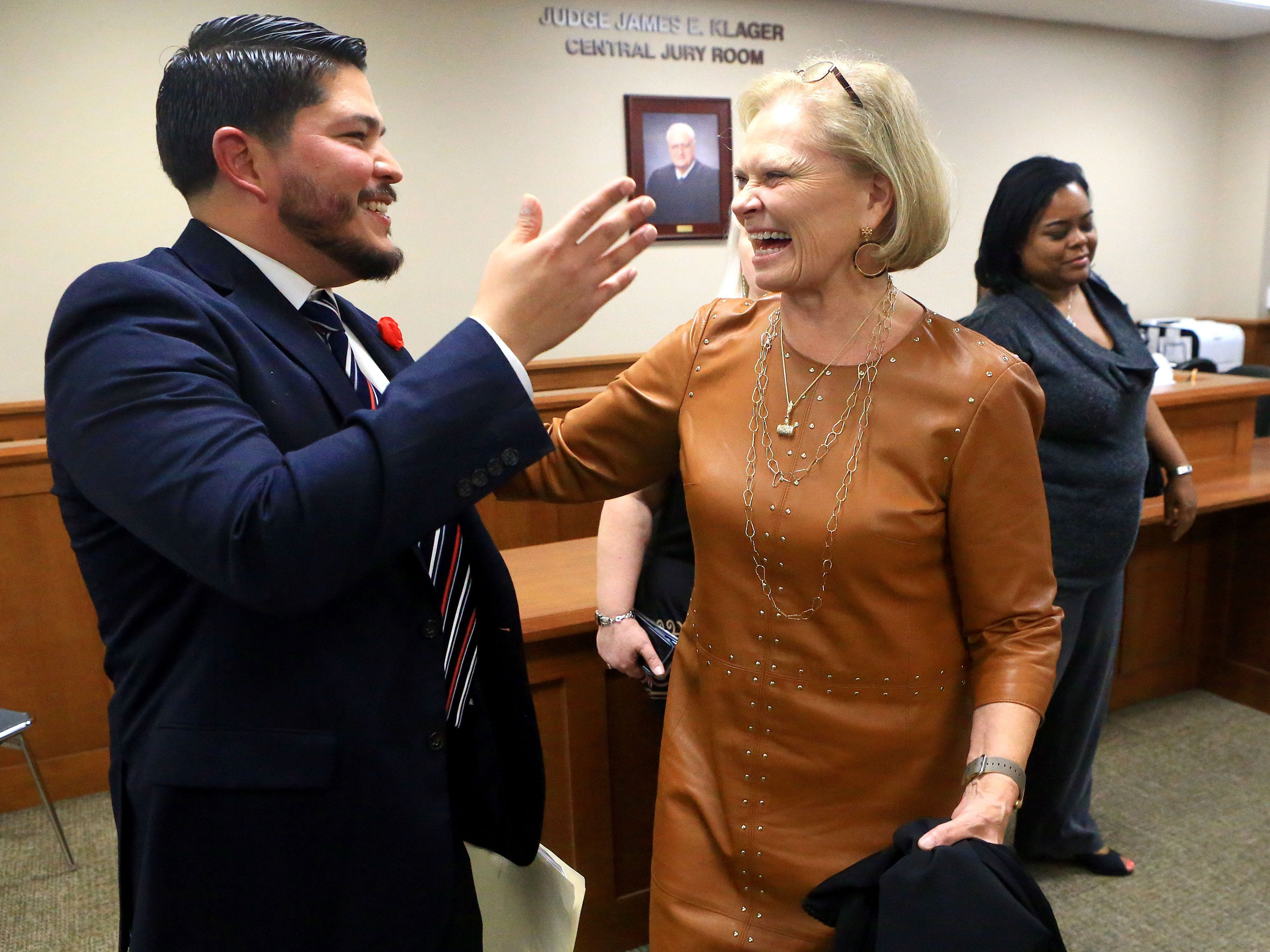 Nueces County District Attorney Mark Gonzalez talks with 117th District Court Judge Sandra Watts after being sworn in at the Nueces County Courthouse in 2017. There are more women judges than ever in Nueces County.